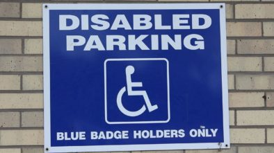 Blue badge holder sign